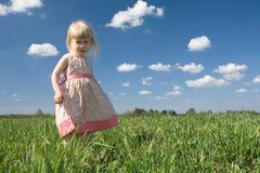 Little girl on green meadow stock photos