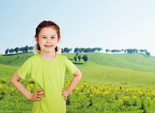 Little girl on the green meadow Royalty Free Stock Photography