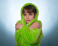 The little girl in a green robe  isolated Stock Image
