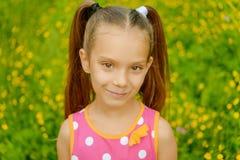 Little girl in green summer city park Stock Images