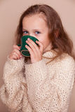 Little girl with green tea Royalty Free Stock Photography