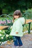 Little girl in green walking park. Royalty Free Stock Photo