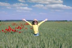 Little girl on green wheat field Stock Photo
