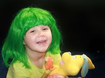 Little girl in green wig Royalty Free Stock Image