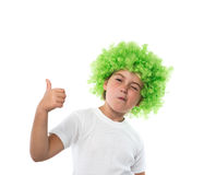 Little girl in green wig. And show ok sign Royalty Free Stock Image