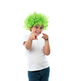 Little girl in green wig Stock Photo