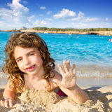 Little girl greeting hand gesture in sandy beach Stock Photos