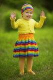 Little girl greets hands up Stock Image