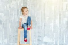 Little girl on a grey background stock image