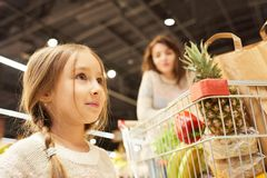 Little Girl Grocery Shopping with Mother stock photography