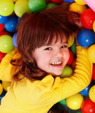 Little girl with group ball. Stock Image