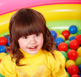 Little girl with group ball. Royalty Free Stock Image