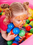 Little girl with group ball. Stock Photography