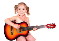 Little girl with guitar Royalty Free Stock Photography