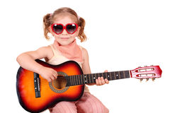 Little girl with guitar Stock Image