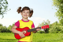 Little girl with guitar Royalty Free Stock Photos