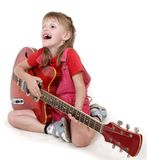 Little girl and guitar Royalty Free Stock Photos