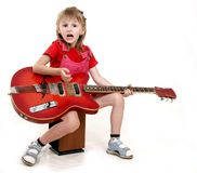 Little girl and guitar Stock Image