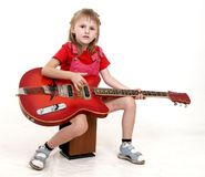 Little girl and guitar Stock Photo