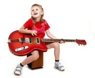 Little girl and guitar Royalty Free Stock Images
