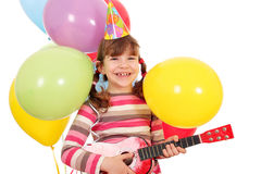 Little girl with guitar and balloons birthday party stock images