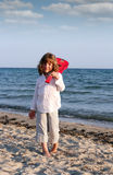 Little girl with guitar on beach Stock Photography