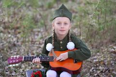 Girl in uniform for the holiday May 9 stock photos