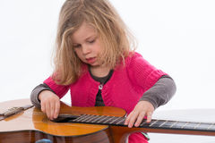 Little girl is with guitar Stock Photo