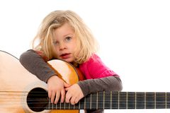 Little girl with a guitar Stock Photography