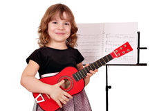 Little girl with guitar posing Stock Image