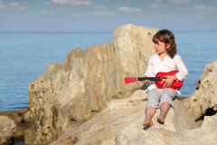 Little girl with guitar Royalty Free Stock Photo