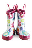 Little girl gumboots. Pair of little girl's fun rain boots galoshes with water droplets on them Royalty Free Stock Photos
