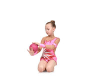Little girl gymnast with ball Royalty Free Stock Photos