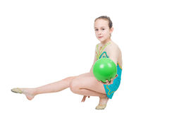 Little girl gymnast with green ball Royalty Free Stock Image