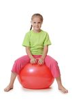 Little girl on a gymnastic ball Royalty Free Stock Photography