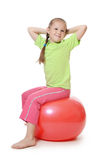 Little girl on a gymnastic ball Stock Image
