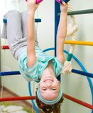 Little girl at gymnastic rings Stock Photos