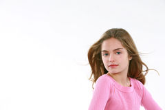 Little girl with hair blowing Royalty Free Stock Photos