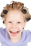 Little girl with hair curlers Royalty Free Stock Images