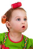 Little girl with hair curlers Stock Photo