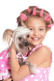 Little girl in hair curlers with dog. Portrait of happy Little pretty girl in hair curlers with dog in studio royalty free stock photo