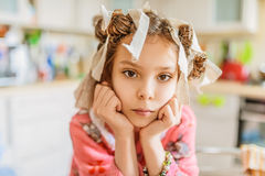 Little girl with hair curlers on her head Royalty Free Stock Photos