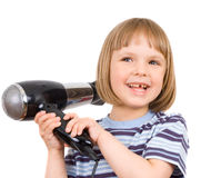 Little girl with hair dryer Royalty Free Stock Image