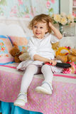 Little girl with hairbrush. Royalty Free Stock Photos
