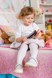 Little girl with hairbrush. Stock Image
