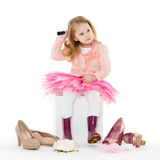 Little girl with hairbrush. Stock Images