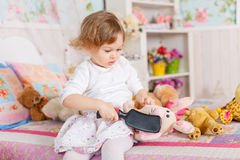 Little girl with hairbrush. Stock Photography