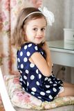 Little girl is hairbrushing Royalty Free Stock Images