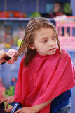 Little girl haircut royalty free stock photos