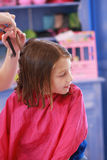 Little girl haircut Stock Image